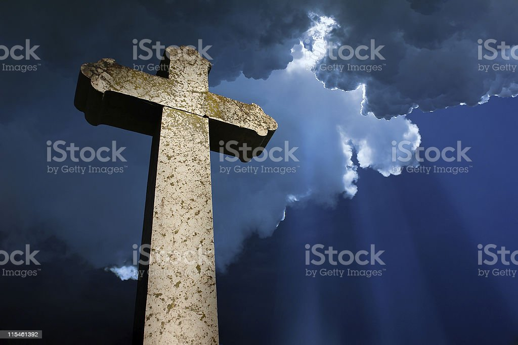 Cross under the clouds stock photo
