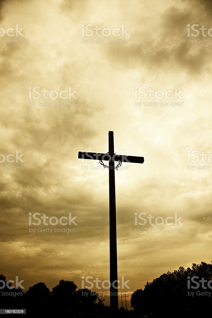 Cross with crown of thorns at sunset royalty-free stock photo