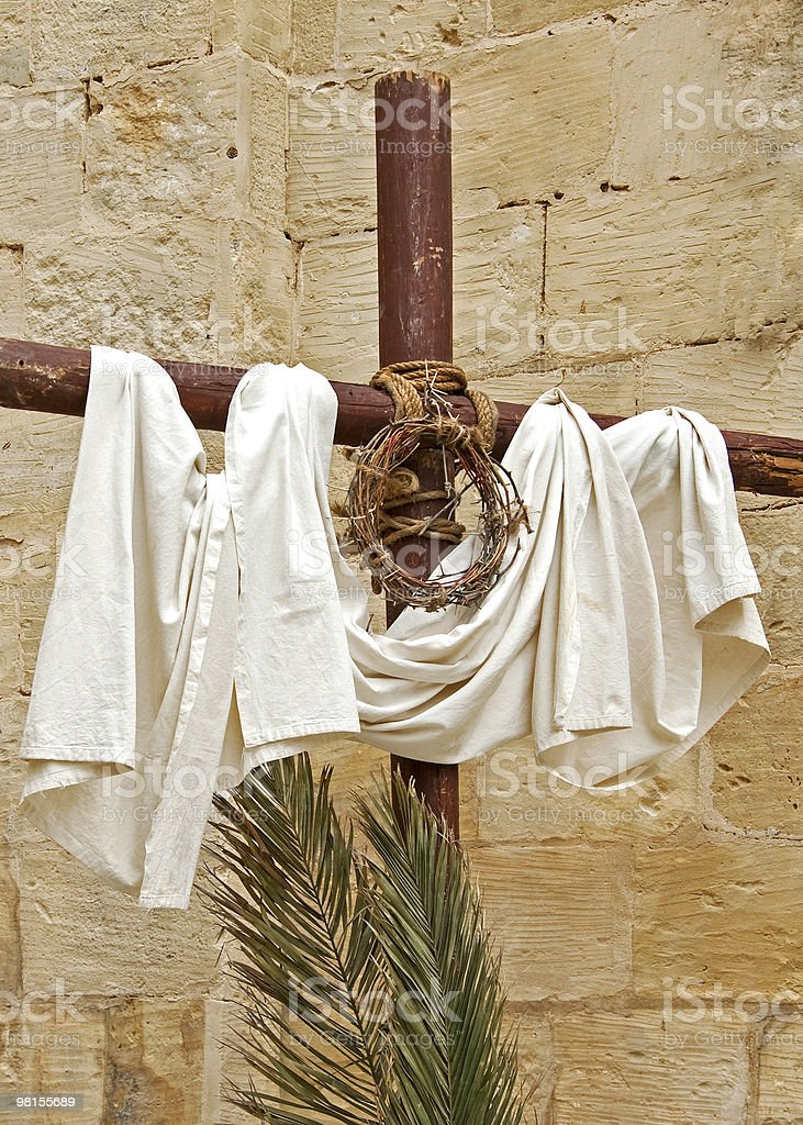 Cross with crown of thorns, white cloth and palm twigs. royalty-free stock photo