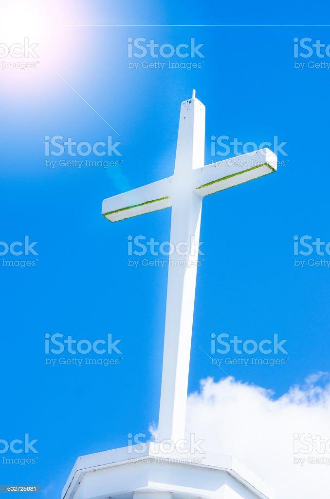 Cross with shiny sun stock photo