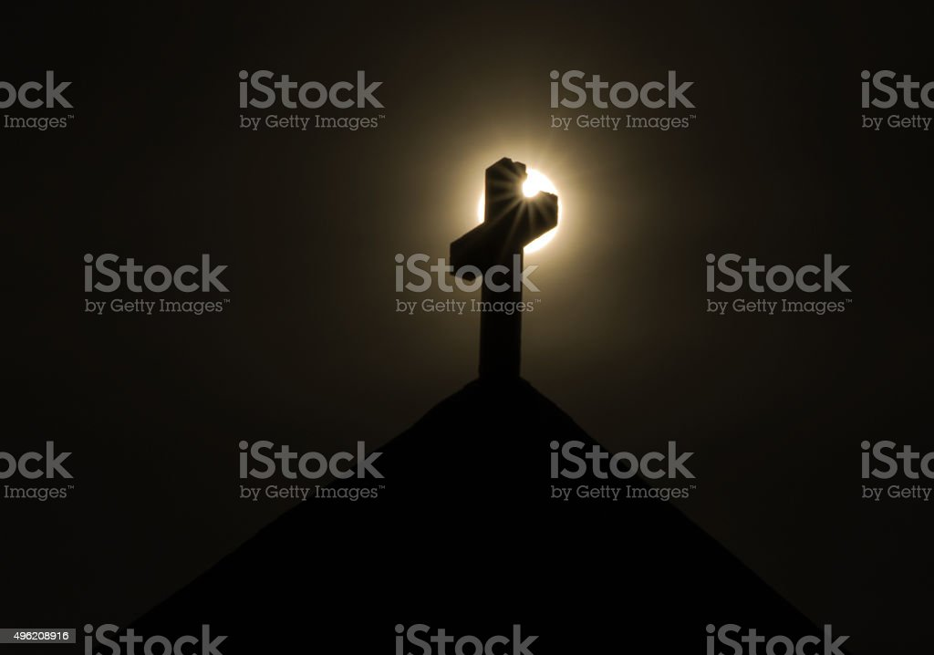Cross with Sunstar stock photo
