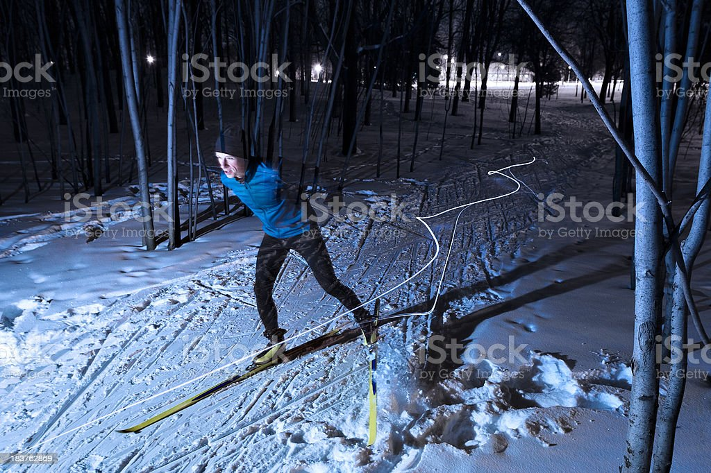 Cross-country skier at night royalty-free stock photo