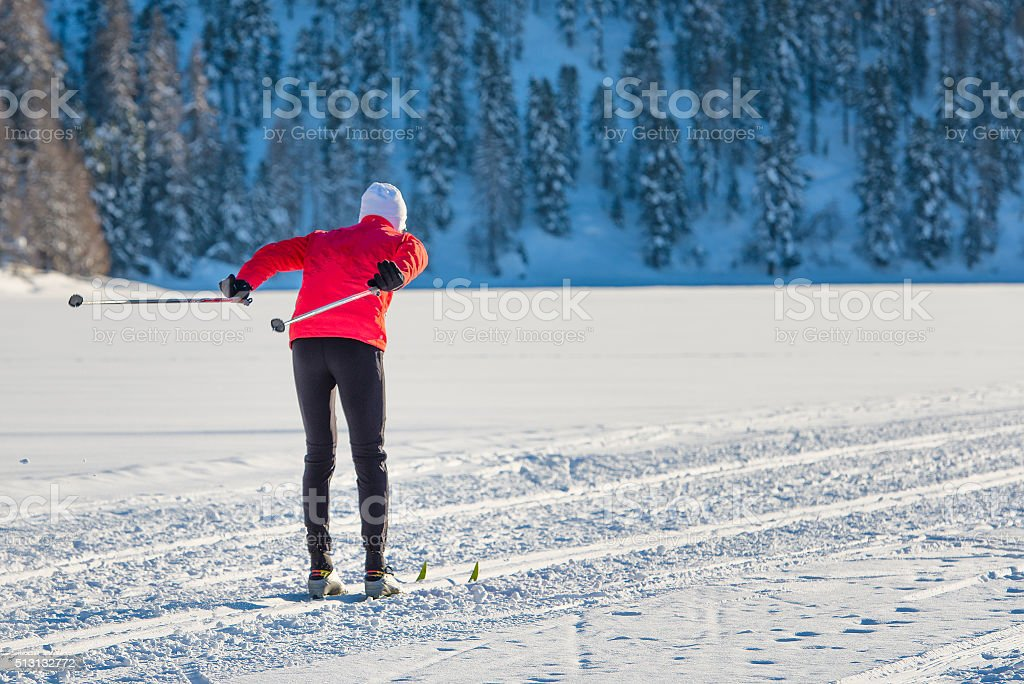 Cross-country skier on track pushes shoe stock photo