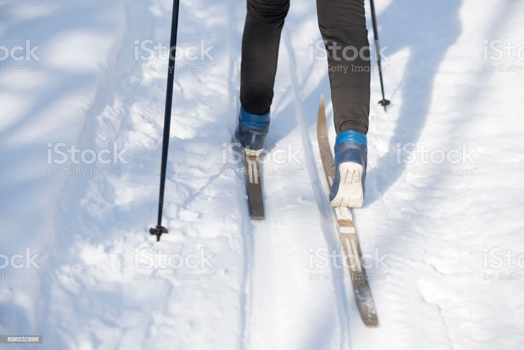 Cross-country skiing. Outdoor winter sport. Ski track.