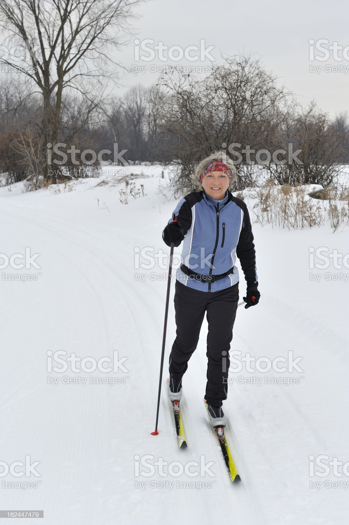 Cross-country skiing, smiling woman, winter sport royalty-free stock photo