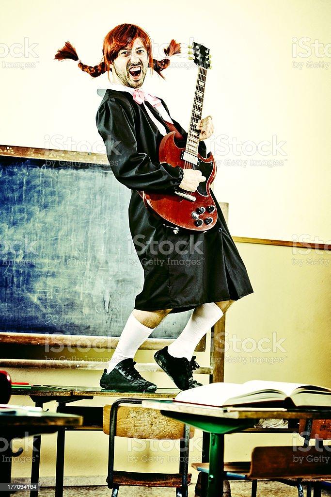 Crossdressed schoolgirl with Guitar. School Music Concept. royalty-free stock photo