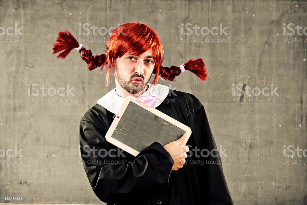 Crossdressed student holding a blank boad royalty-free stock photo