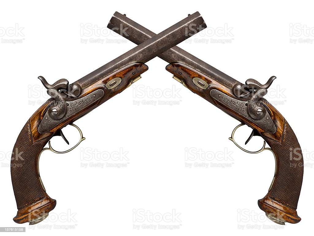 Crossed Antique Pistols Isolated on White. stock photo