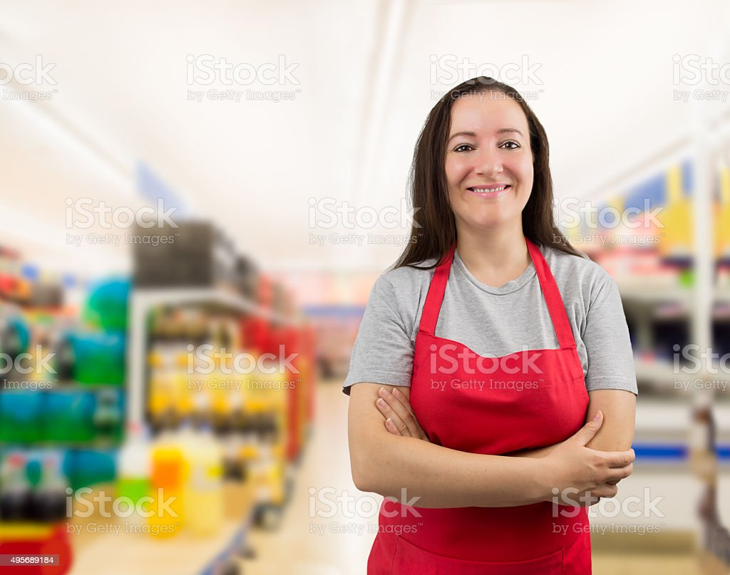 crossed arms at the supermarket stock photo