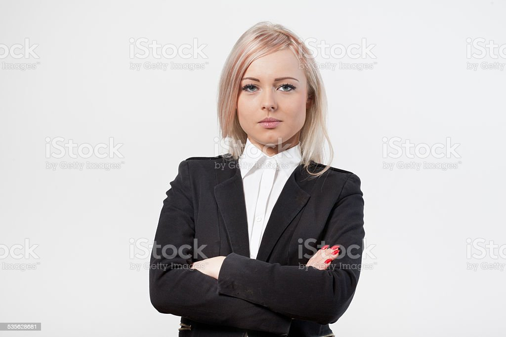 crossed arms self confident woman stock photo