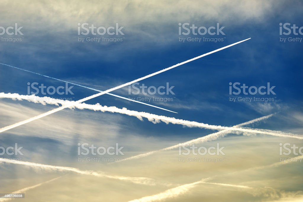Crossed contrails in the sky stock photo