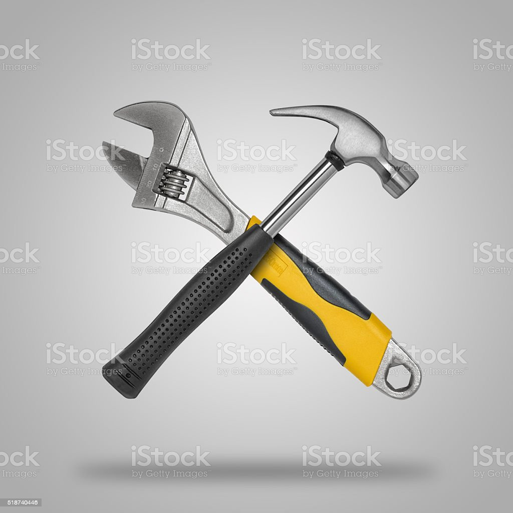 Crossed hammer and wrench stock photo