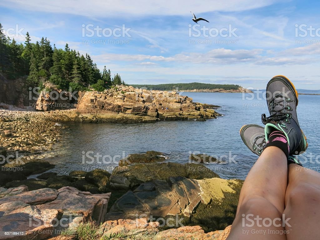 Crossed Legs Maine Acadia National Park Rocky Shoreline, Maine stock photo