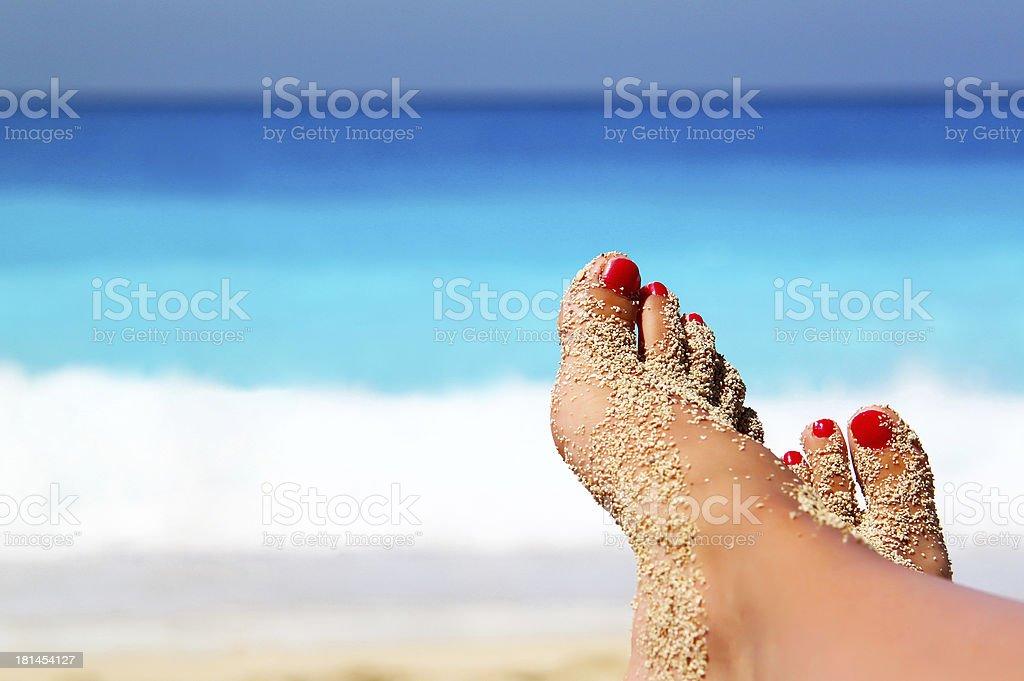 Crossed legs on the beach stock photo