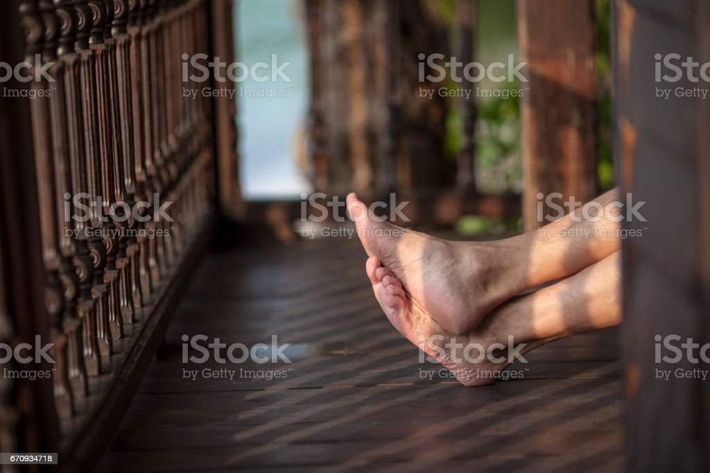 Crossed male legs. stock photo