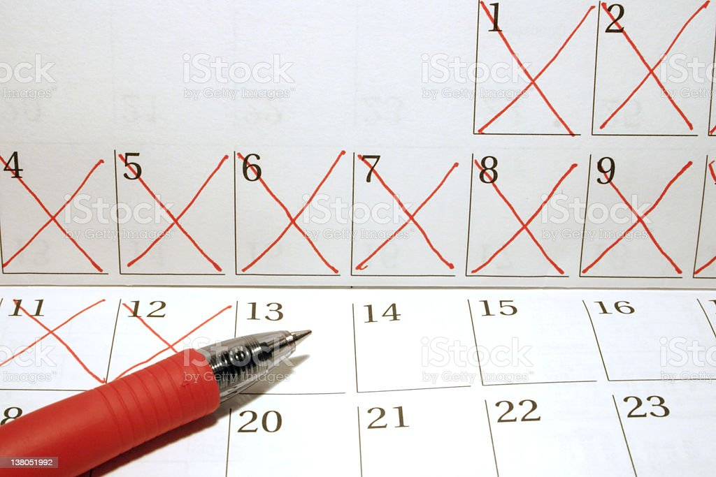 Crossed out dates on calendar royalty-free stock photo