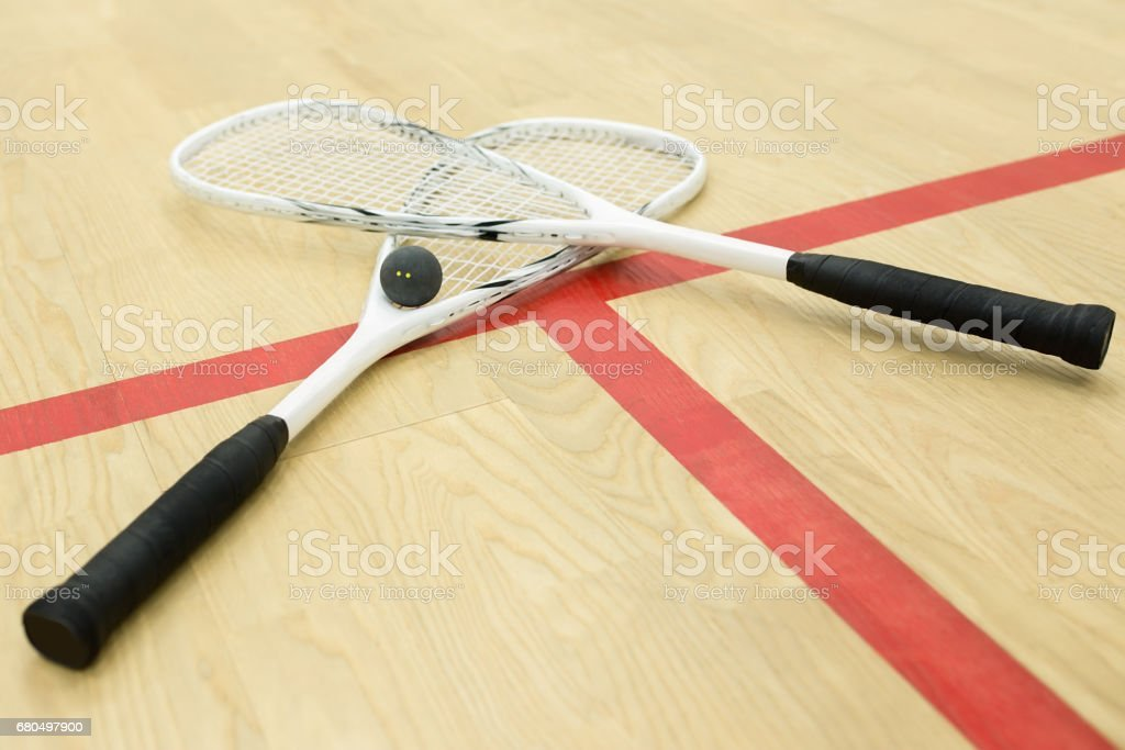 crossed squash rackets stock photo