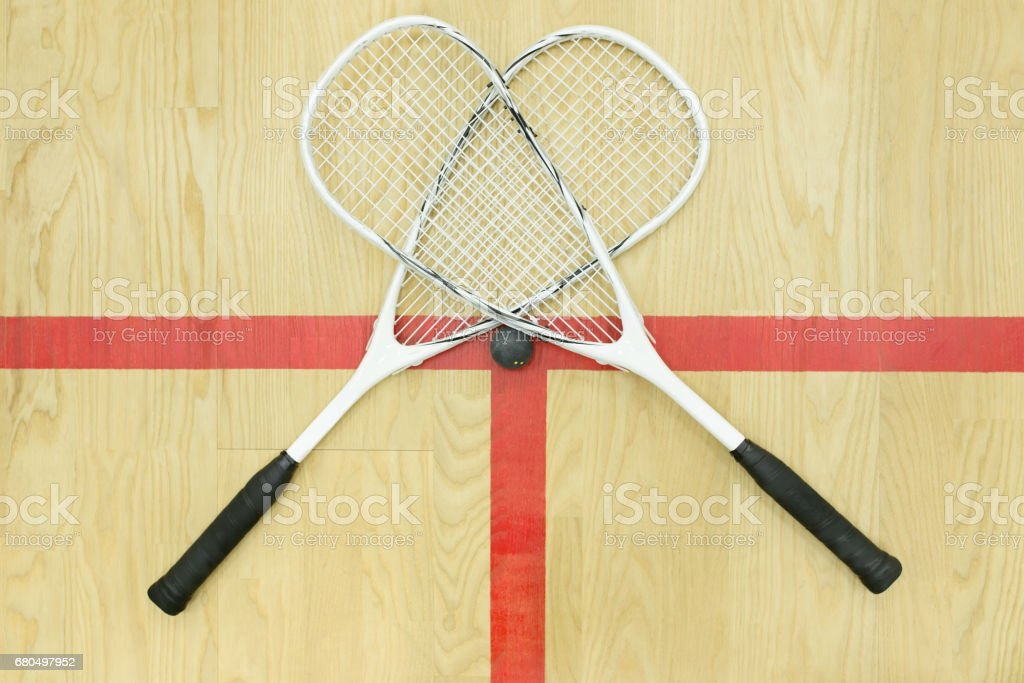 crossed squash rackets top view stock photo