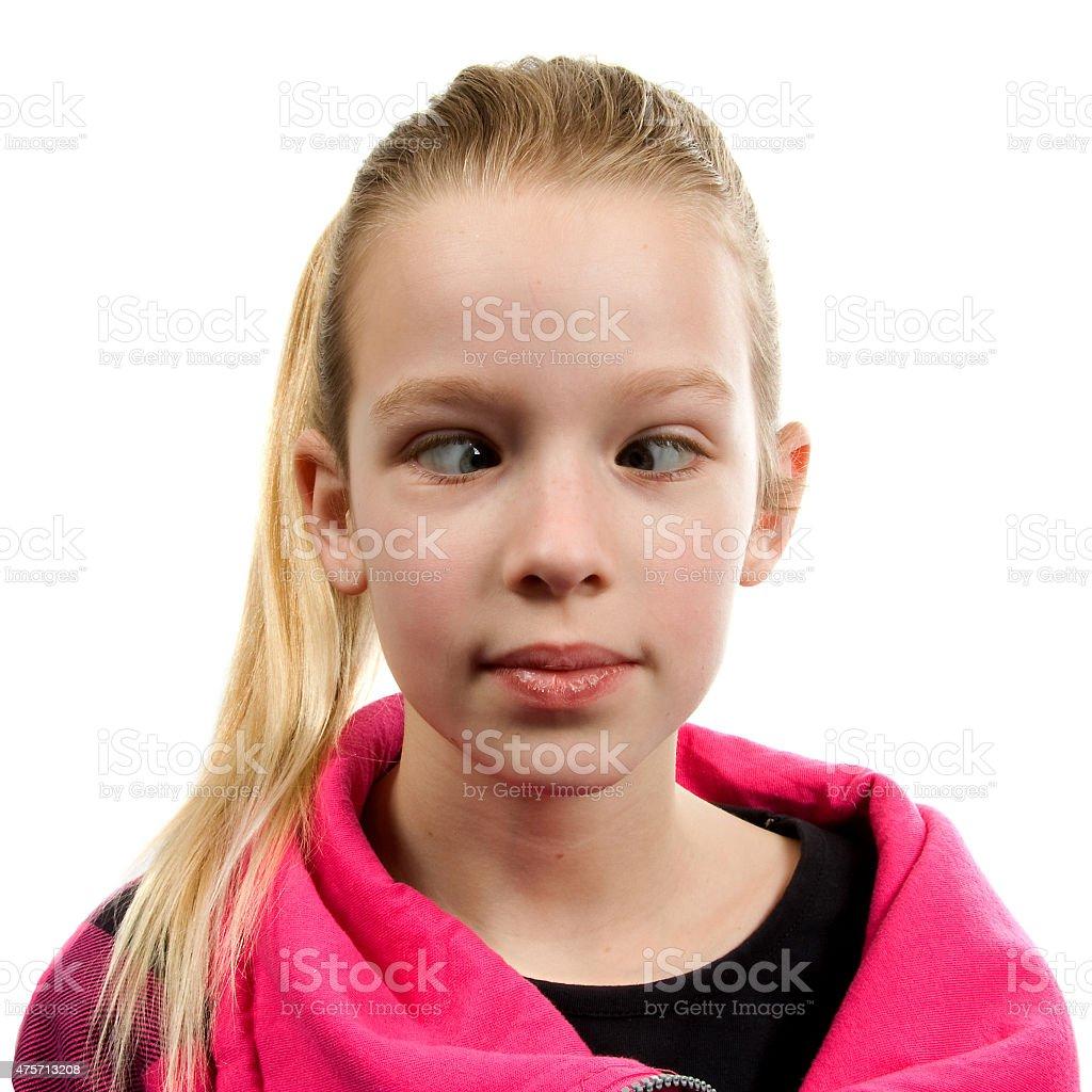Crossed-eyed girl over white background stock photo