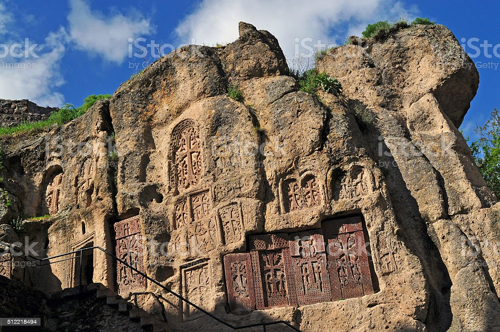 Crosses in the rock, in the monastery of Geghard stock photo