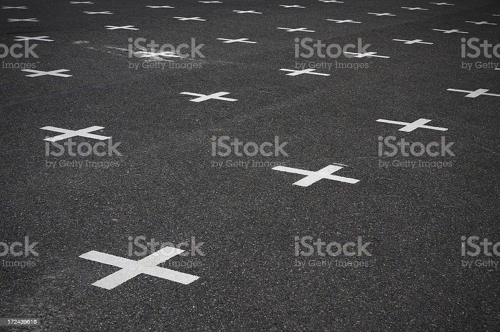 Crosses on asphalt royalty-free stock photo