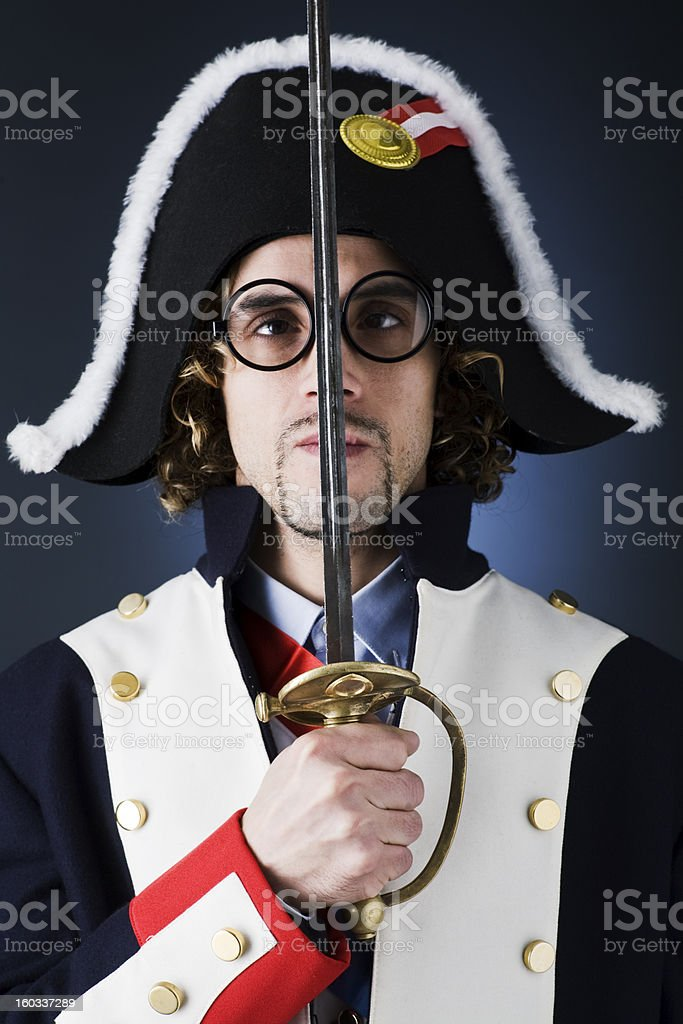 Cross-eyed french soldier dressed like Napoleon. stock photo