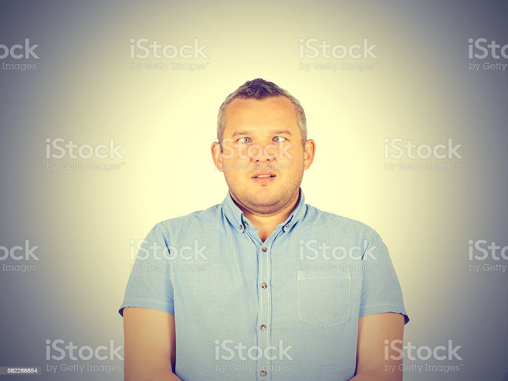 Cross-eyed man, funny faces. stock photo