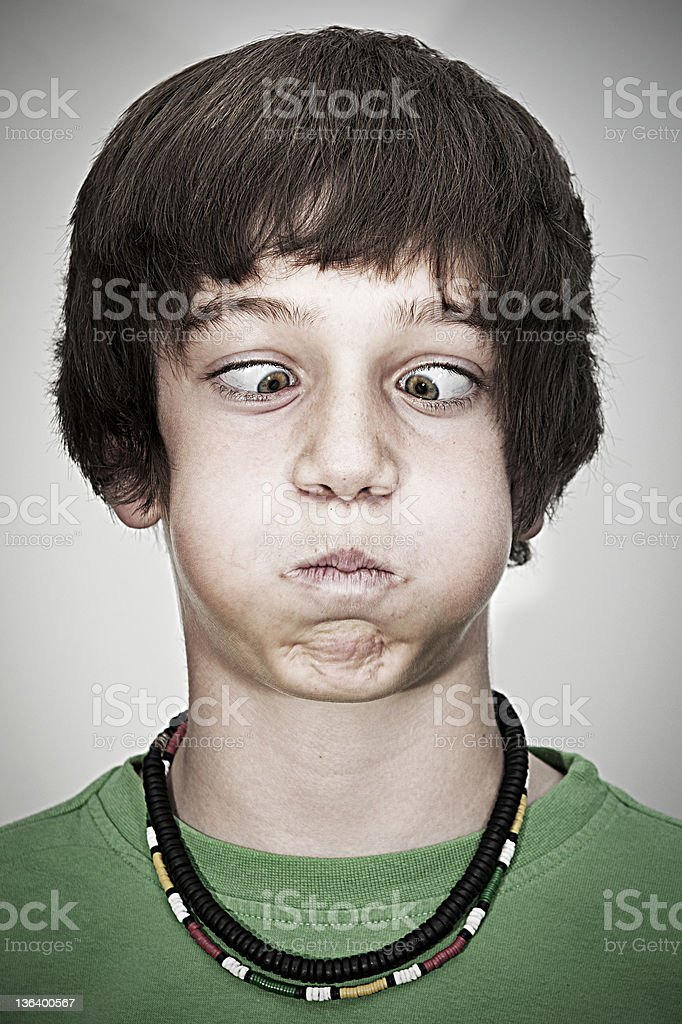 cross-eyed young teenager boy royalty-free stock photo