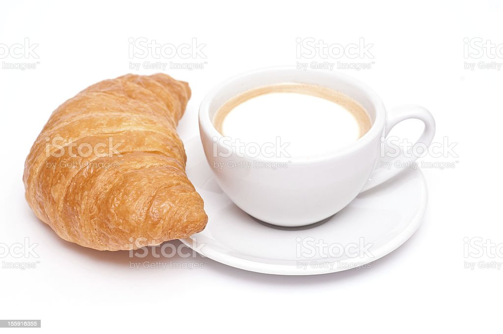 Crossiant and a cup of cappuccino stock photo