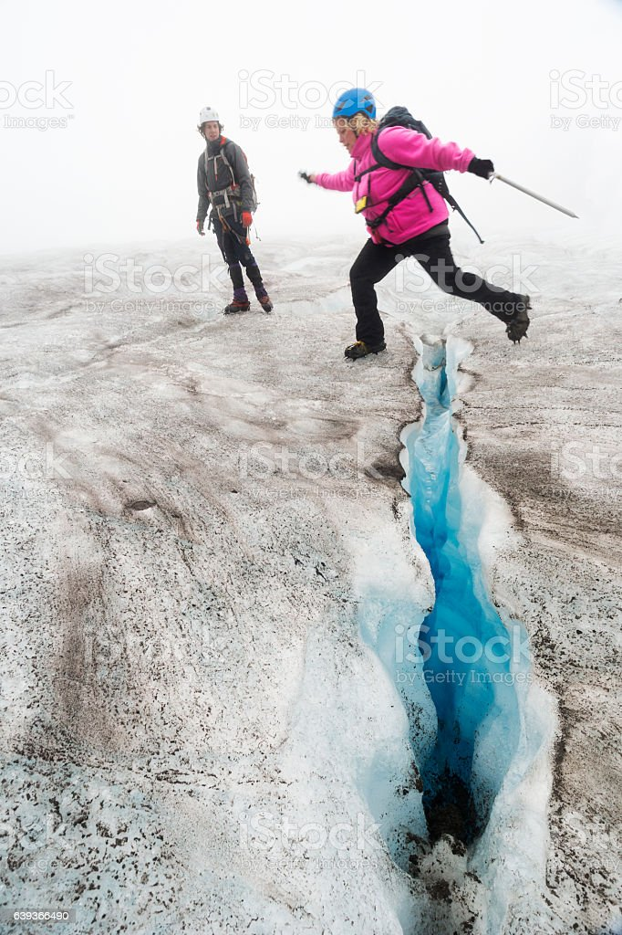 Crossing a crevasse stock photo