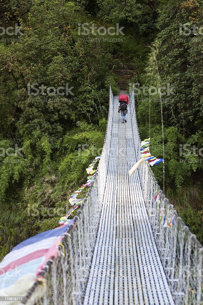 Crossing a suspension bridge royalty-free stock photo