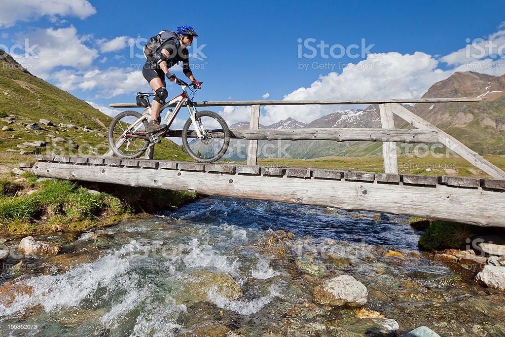 Crossing alpine creek, South Tyrol royalty-free stock photo
