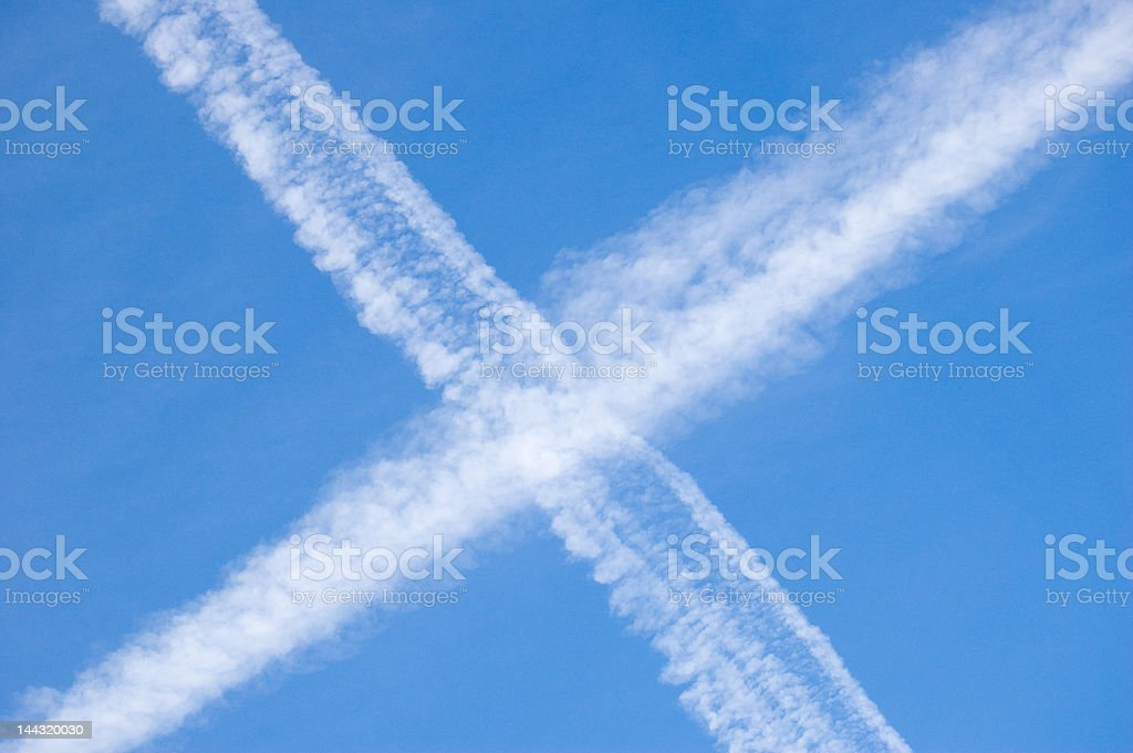 crossing contrails royalty-free stock photo