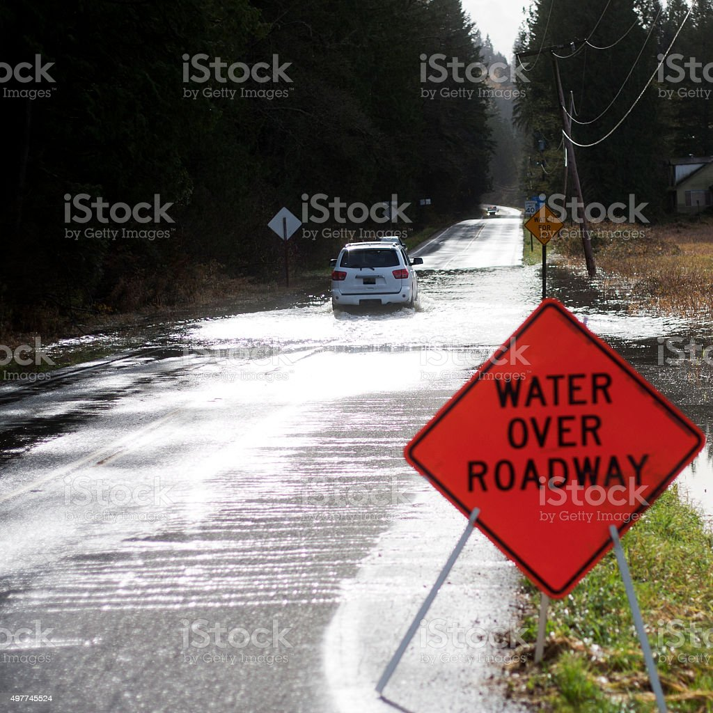 SUV Crossing Flooded Carnation Farm Road stock photo