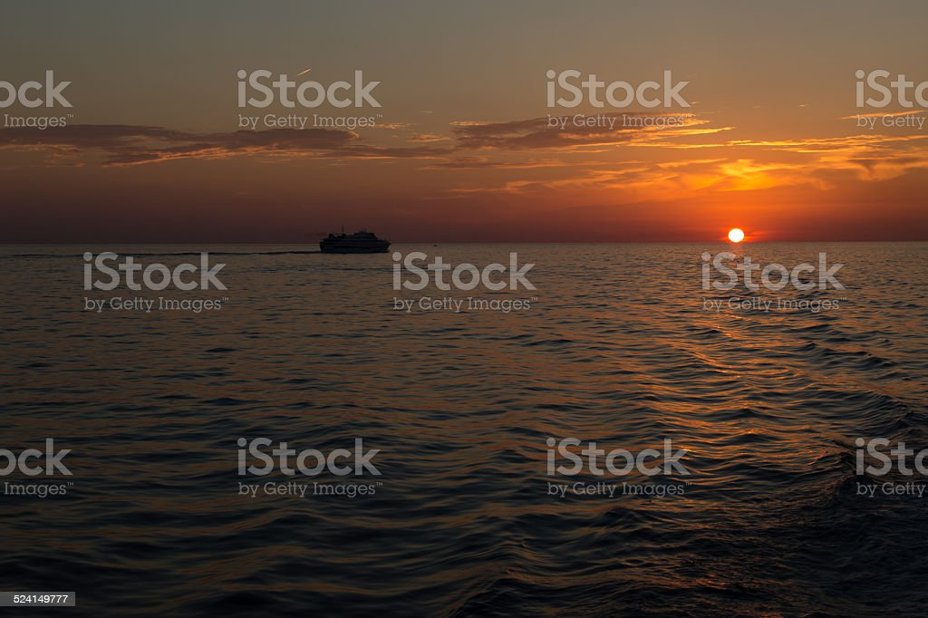 Crossing from Sicily at sunset. stock photo