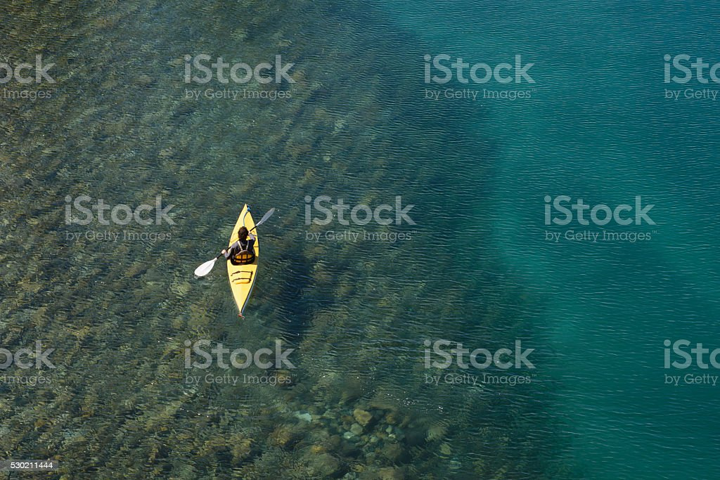 Crossing Kayak Paddling the Lakes of Patagonia, Argentina. stock photo