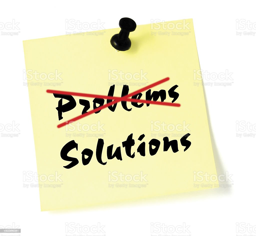 Crossing out problems writing solutions sticky note, isolated black pushpin stock photo