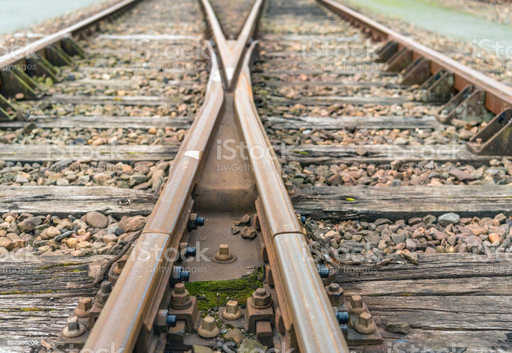 Crossing rusty rails from close stock photo