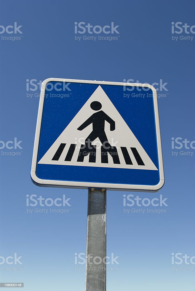 crossing sign. Blue crosswalk sign isolated on blue. royalty-free stock photo