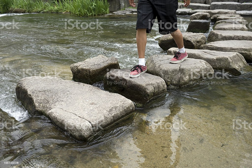 Crossing Stepping Stones royalty-free stock photo