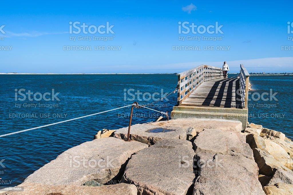 Crossing the Breakwater Bridge stock photo