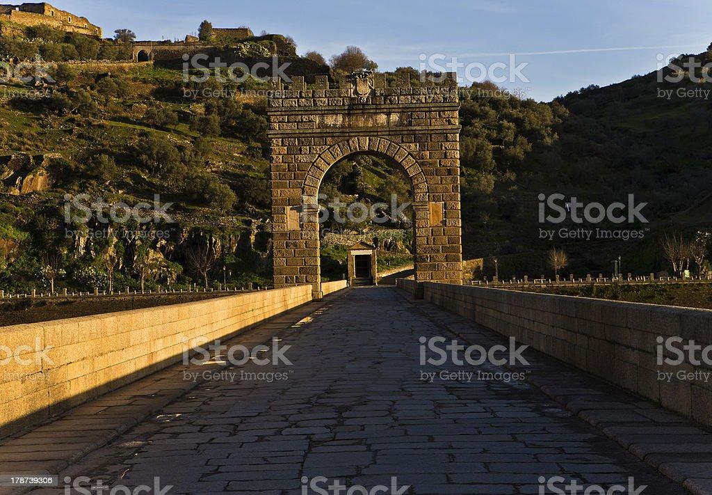 Crossing the Bridge of Alcantara stock photo