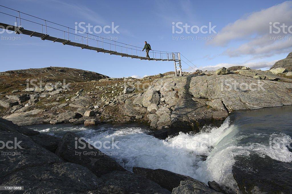 Crossing the bridge stock photo