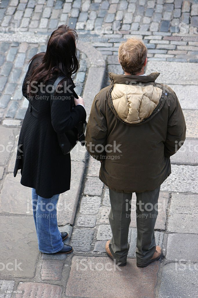 crossing the cobble street royalty-free stock photo