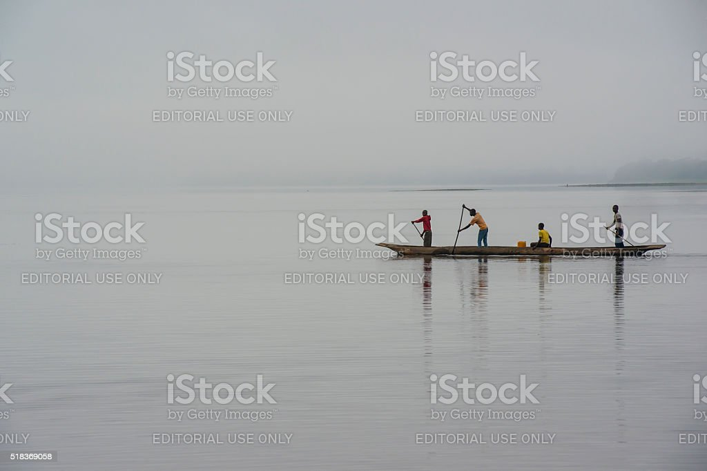 Crossing the Congo River on a dugout canoe stock photo