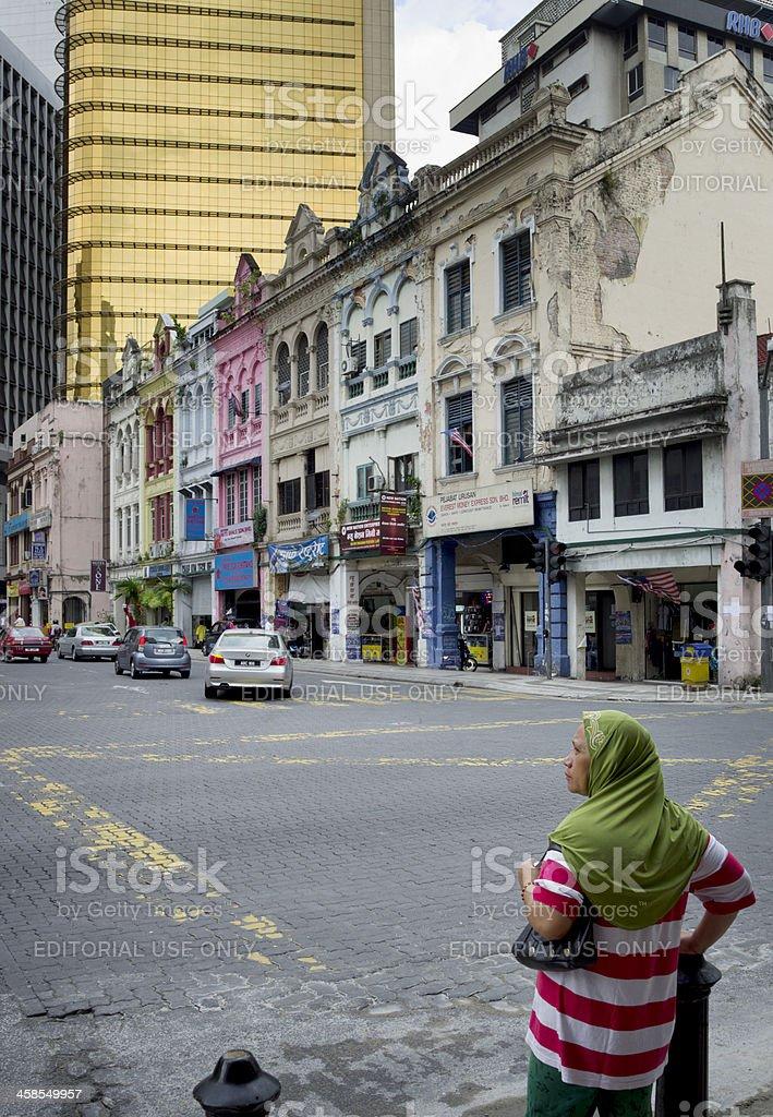 Crossing the street in Kuala Lumpur royalty-free stock photo