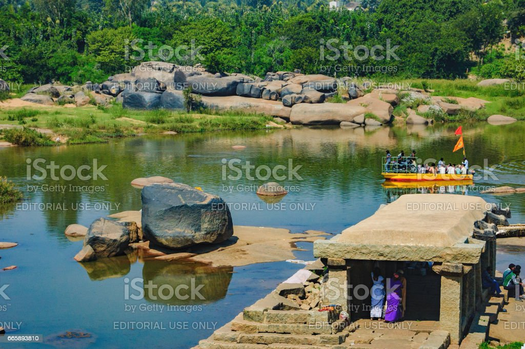 Crossing the Tungabhadra River in Hampi, India stock photo
