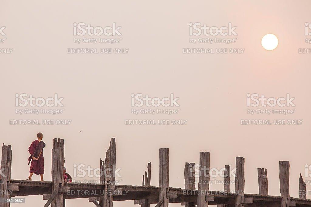 Crossing the U Bein Teak Bridge royalty-free stock photo