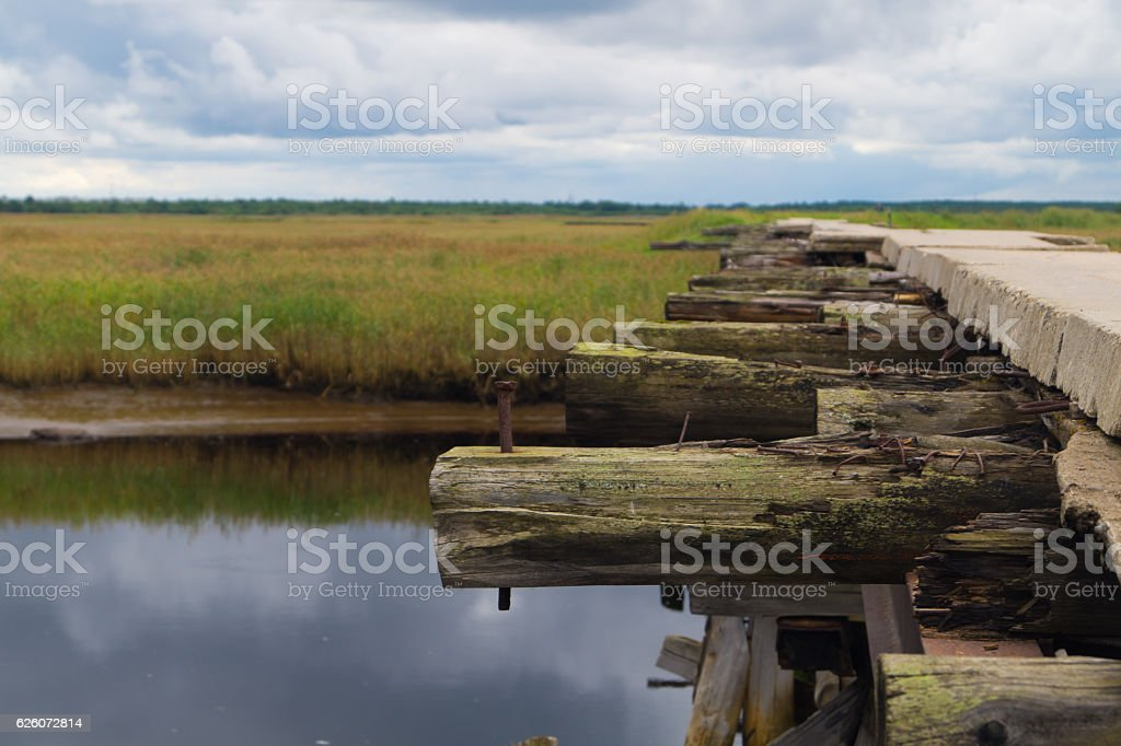 Crossing wooden log bridge closeup background stock photo