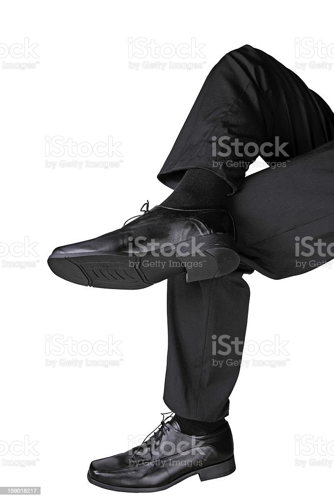 cross-legged businessman stock photo